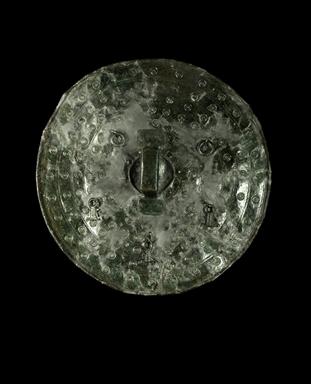 Scudo in bronzo dalla tomba 77 in località Brecce